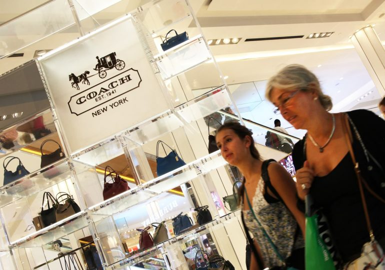 Coach-owner Tapestry sales fall 7% in holiday quarter, sees 2021 revenue up by high-single digits