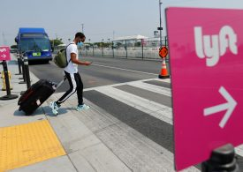 Lyft stock rises more than 10% after company reports signs of pandemic recovery