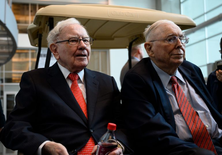 Berkshire's annual meeting is Saturday with Buffett and Munger together again, shares at a record