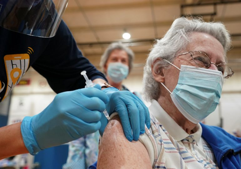CDC director says hospitalizations among seniors are declining as more than half of the age group is fully vaccinated