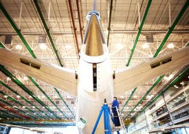 Boeing posts loss as Dreamliner flaws drive up costs, but airplane sales rise